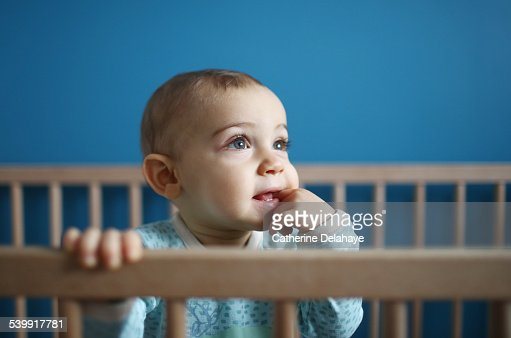 a 1 year old baby boy in his playpen stock photo getty images. Black Bedroom Furniture Sets. Home Design Ideas