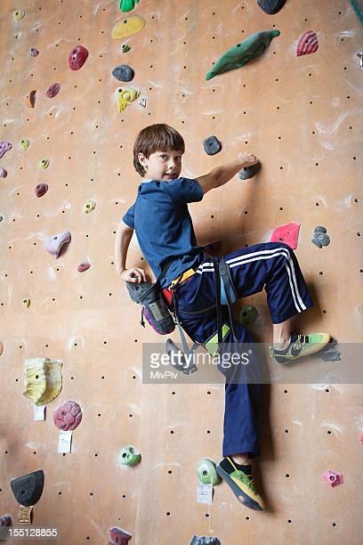 10 year old boy on a rock climbing wall