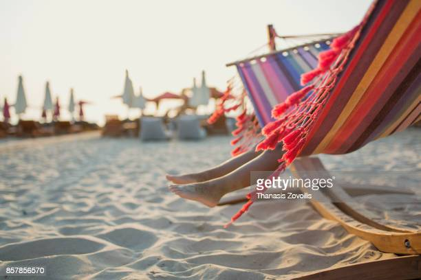 6 year old boy sitting on a hammock on the beach