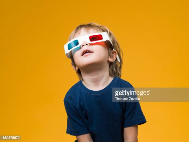 2 year old boy wearing 3D glasses