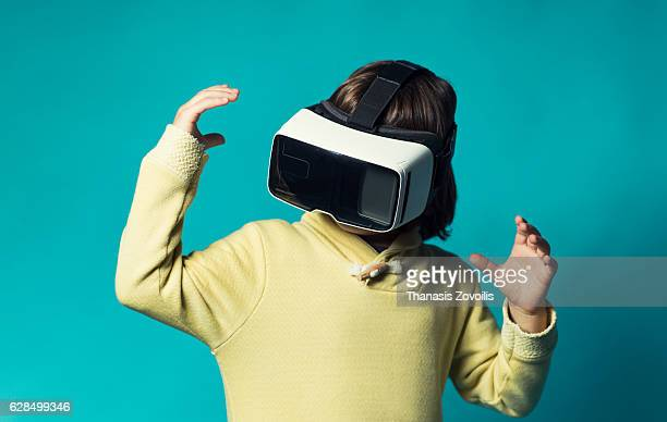 5 year old boy wearing virtual reality glasses