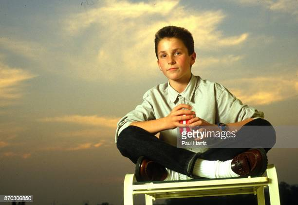 13 year old Christian Bale at the Beverly Hilton Hotel during a publicity tour for Empire Of The Sun He sits on a deck chair beside the swimming pool...