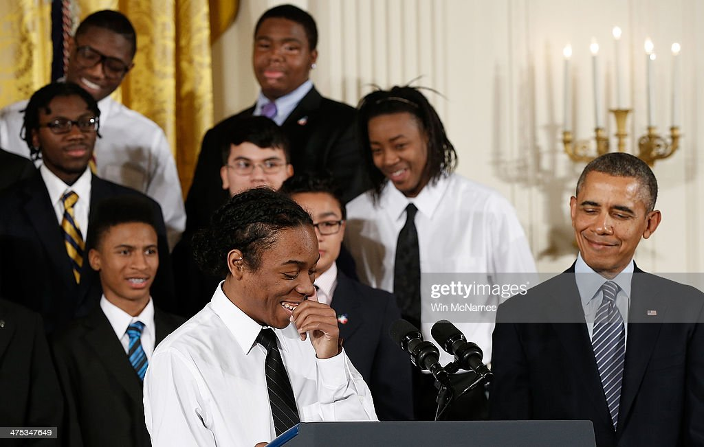 18 year old Christian Champagne, from the Hyde Park Career Academy in Chicago, laughs during his introduction of U.S. President <a gi-track='captionPersonalityLinkClicked' href=/galleries/search?phrase=Barack+Obama&family=editorial&specificpeople=203260 ng-click='$event.stopPropagation()'>Barack Obama</a> (R) during an event in the East Room of the White House February 27, 2014 in Washington, DC. Obama signed an executive memorandum following remarks on the ÒMy BrotherÕs KeeperÓ initiative.