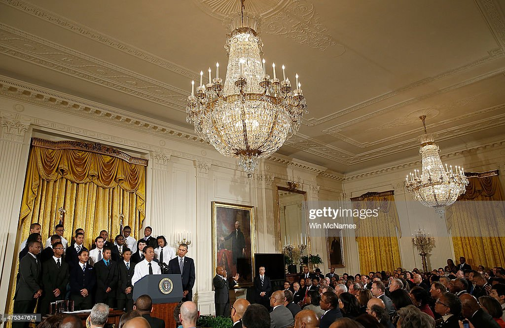 18 year old Christian Champagne, from the Hyde Park Career Academy in Chicago, introduces U.S. President <a gi-track='captionPersonalityLinkClicked' href=/galleries/search?phrase=Barack+Obama&family=editorial&specificpeople=203260 ng-click='$event.stopPropagation()'>Barack Obama</a> (R) during an event in the East Room of the White House February 27, 2014 in Washington, DC. Obama signed an executive memorandum following remarks on the ÒMy BrotherÕs KeeperÓ initiative.