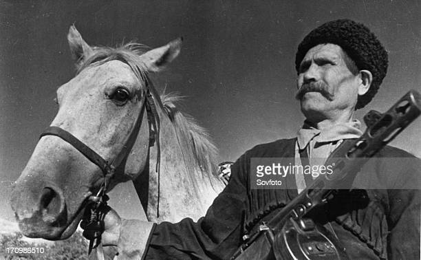 60 year old cossack pavel kamnev of the guards corps commanded by lieutenantgeneral kirichenko kamnev together with his two sons volunteered to fight...