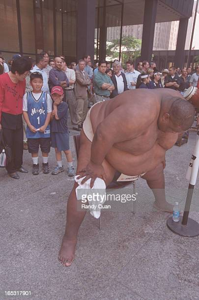 8 year old David Sugimura and his 11 year old brother Paul watch in amazement as 720 pound Emanuel Yarbrough warms up for his sumo match at the TD...