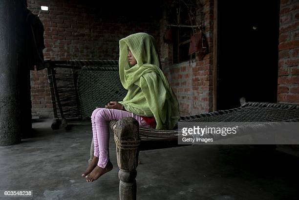 7 year old Dipti poses for a photo on her roof where she was raped two years ago on September 9 2016 in Uttar Pradesh India Two years ago when she...