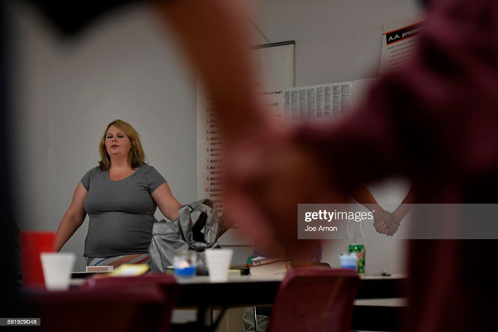 37 year old Emily Lynn Stock leads the serenity prayer after a candle light 12 step meeting in the Fort Lyon Supportive Residential Community Emily...