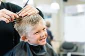 5 Year Old Getting A Haircut at the barber shop.