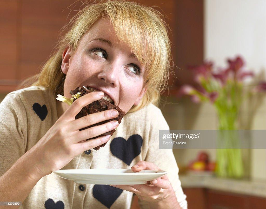 21 year old girl binge eating chocolate cake