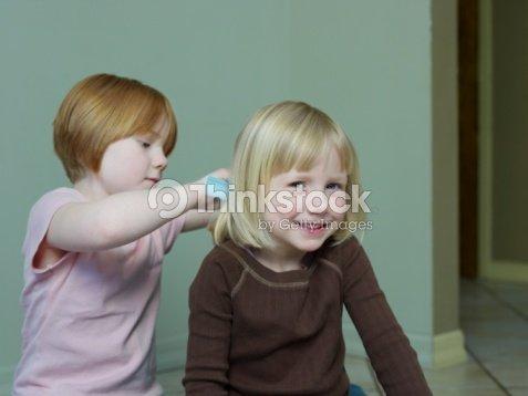 78 Year Old Girl Combs 45 Year Old Girls Hair Foto De Stock Thinkstock