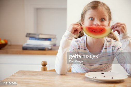 7 year old girl eating watermelon : Stock Photo