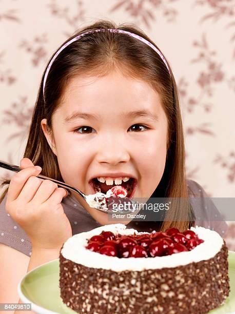 8 year old girl enjoying black forest gateau