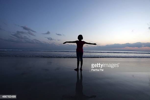 A 9 year old girl enjoying Sunset,Radhanagar Beach