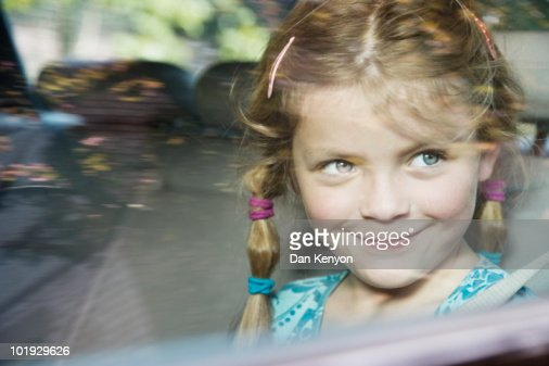 6 year old Girl in car - portrait