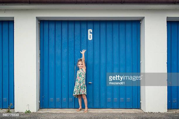 6 year old girl in front of garage door with number 6