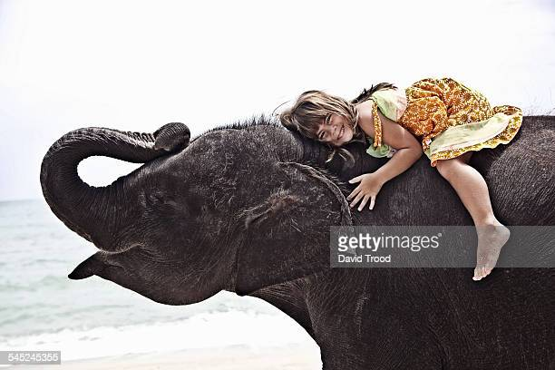 5 year old girl on baby elephant