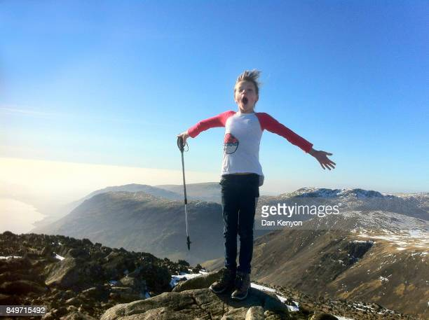 11 year old girl on mountain top