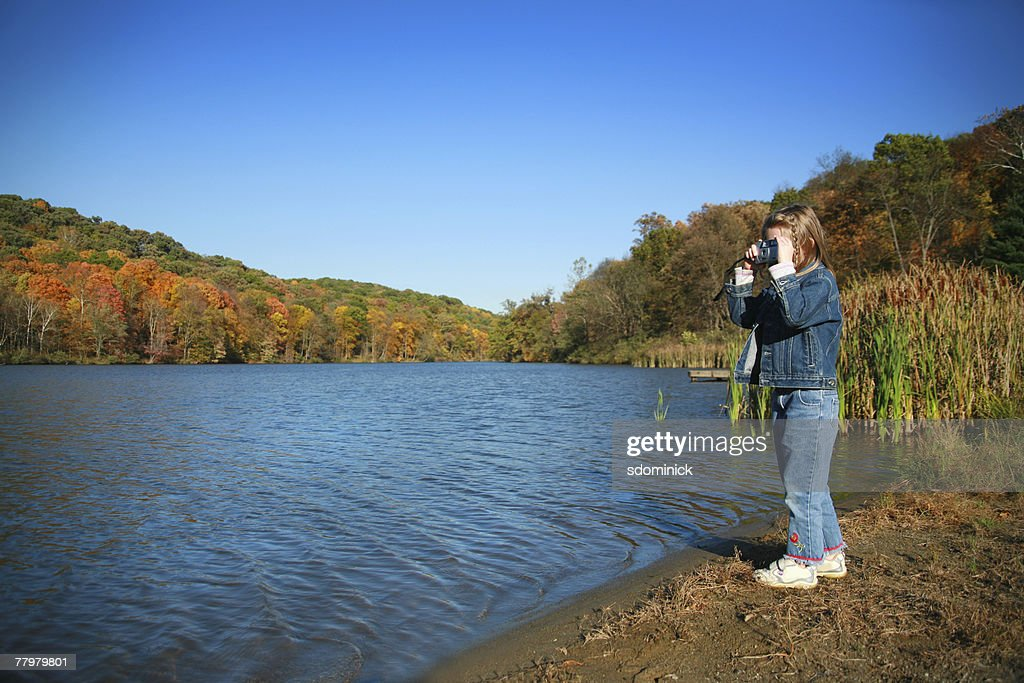 A 5 Year Old Girl Photographing A Beautiful Fall Scene