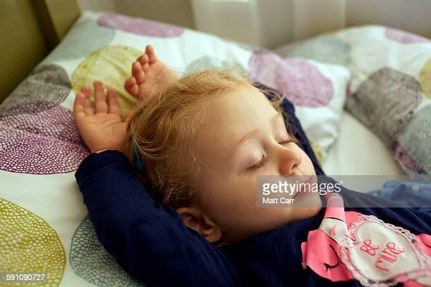 2 Year old girl sleeping in bed