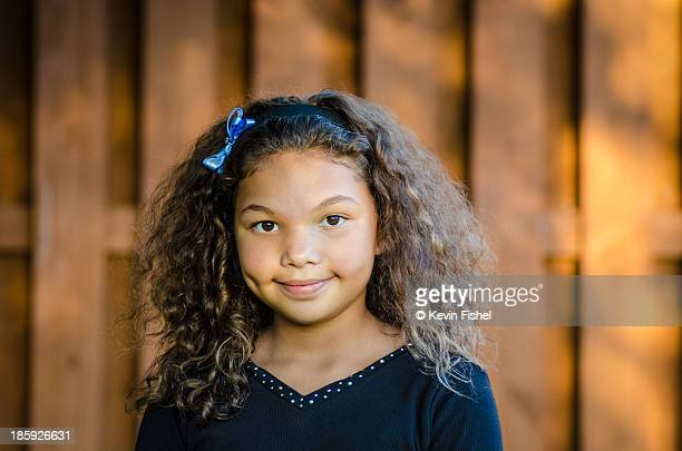 9 Year Old Girl Smiling in Golden Light