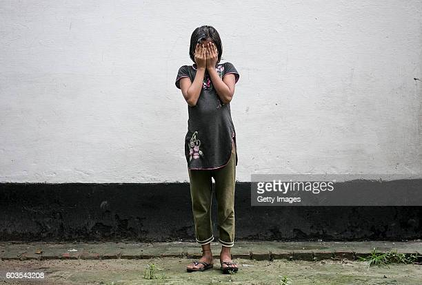 9 year old Gitanjali poses for a photo on August 1 2016 in Uttar Pradesh India Her 30 year old father sexually abused her for years and raped her...