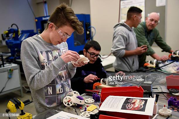 17 year old Jesus Dillalpando at work building a flywheel car using 3D printed components during a technician class at Emily Griffith Technical...
