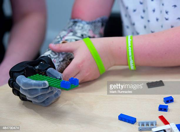 9 year old Josh Cathcart from Dalgety Bay shows the versatility of his new hand during the final fitting for his new bionic hand at Touch Bionics'...