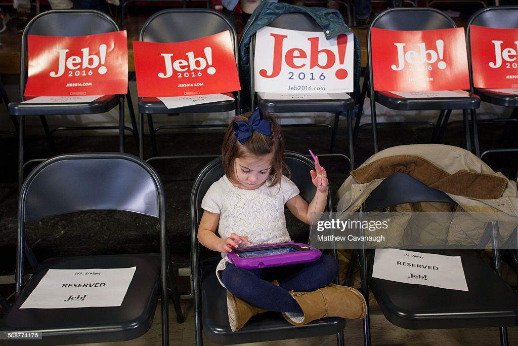 4 Year old Juliet Stevens plays on a tablet at a town hall style meeting with Republican presidential candidate Jeb Bush on February 6, 2016 at the McKelvie Intermediate School in Bedford, New Hampshire. Bush is campaigning in the lead up to the The New Hampshire primary, February 9.