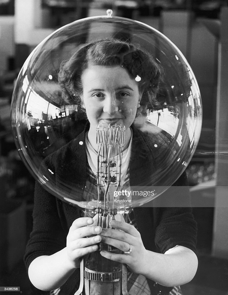 19 year old Kathleen Browne helps make enormous bulbs for use in lighthouses around the British coastline at the lamp factory in Wembley, Middlesex.