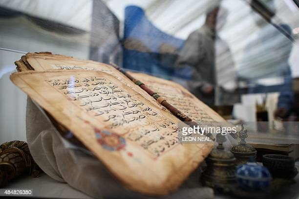 A 750 year old Koran is on show at an annual threeday event for members of the Ahmadiyya Muslim community known as the Jalsa Salana in Hampshire on...
