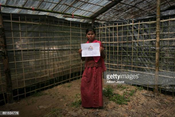 COX'S BAZAR BANGLADESH SEPTEMBER 21 12 year old Kurshida holds her drawing at a CODEC and UNICEF 'child friendly space' on September 21 2017 in Cox's...