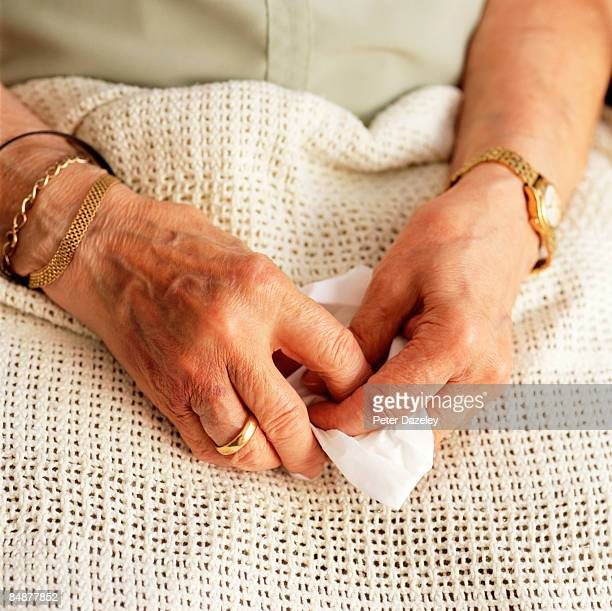 80 year old ladies hands holding tissue