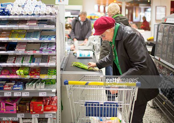 A 75 year old lady doing her shopping at the supermarket pictured on October 15 2013 on the island of Borkum Germany Photo by Ute Grabowsky/Photothek...