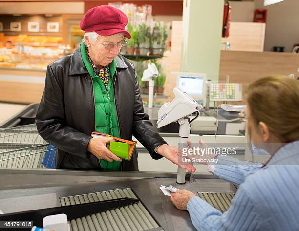 A 75 year old lady paying for her shopping at the check out at a supermarket pictured on October 15 2013 on the island of Borkum Germany Photo by Ute...