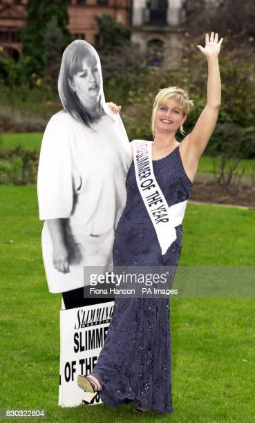 30 year old London postwoman Jacqui Buck with a 'before' image of herself in central London after being named Slimming magazine's Slimmer of the Year...