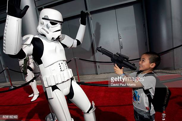 4 year old Luke Yoda plays with some of the models at the San Francisco World Premiere of 'Star Wars Episode III Revenge of the Sith' at the Loews...