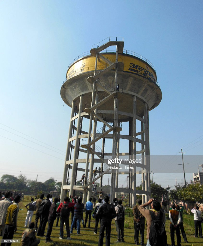 A 38 year old man who jumped off from a water-tank at Vijay Nagar as police and locals looked on, Victim was later declared dead on December 12, 2012 in Ghaziabad, India.