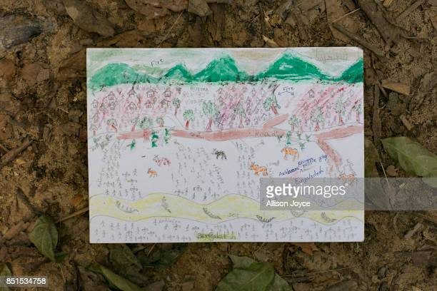 COX'S BAZAR BANGLADESH SEPTEMBER 21 11 year old Manzur Ali's drawing is seen at a CODEC and UNICEF 'child friendly space' on September 21 2017 in...