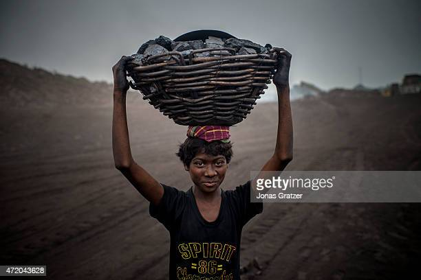 16 year old MD Kahn is a worker at the Jharia coal mine Jharia in India's eastern Jharkand state is literally in flames This is due to the open cast...