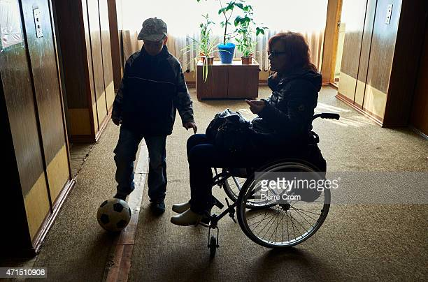 8 year old Misha from Lugansk plays with his football alongside his disabled mother on April 29 2015 in Odessa Ukraine His family sought safety from...