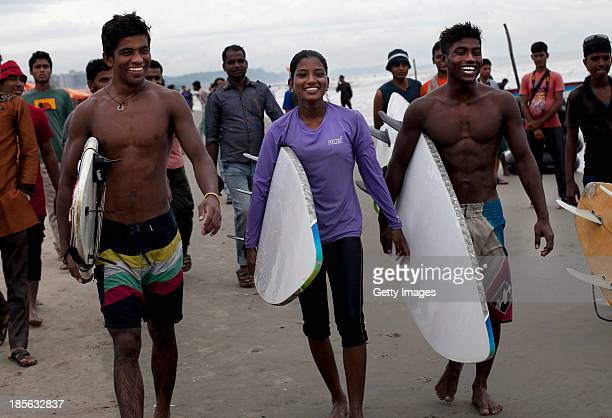 COX'S BAZAR BANGLADESH OCTOBER 22 18 year old Nassima Akter and Kamrul Hasan are seen on the beach after surfing on October 22 2013 in Cox's Bazar...