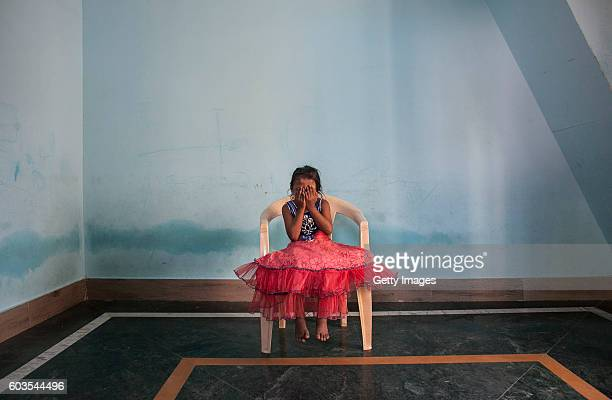 5 year old Nirmala who was raped by her mother's boss poses for a photo on November 12 2015 in Maharashtra India One day Nirmala's mother gave her...