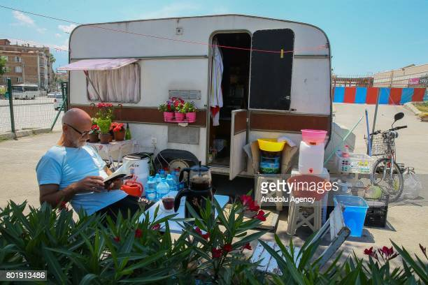 67 year old Ozdemir Turan who is the only wirewalker of Turkey live at his caravan where he lodge at the parking area of a shopping mall as he takes...