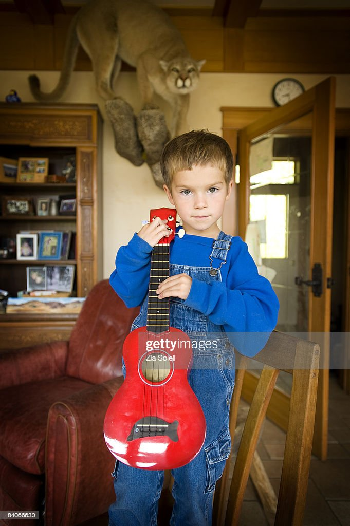 4 year old poses with his ukelele & mountain lion : Stock Photo