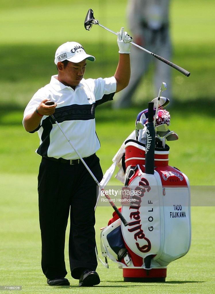 15 year old qualifier Tadd Fujikawa from Hawaii pulls somes clubs from his bag during the Monday practice round for the 2006 US Open Championship at...