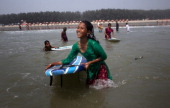 COX'S BAZAR BANGLADESH APRIL 12 12 year old Rifa who has been working for 4 years surfs April 12 2014 in Cox's Bazar Bangladesh A group of 1012 year...