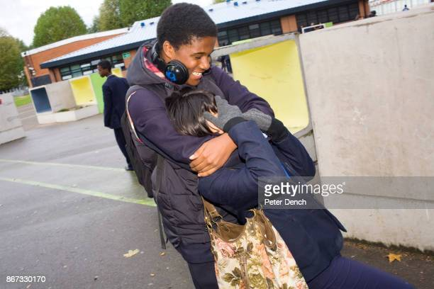 15 year old Robyn Kullar messes around with Omar Austin during her lunchtime break at Villiers High School Villiers High School is in the town of...