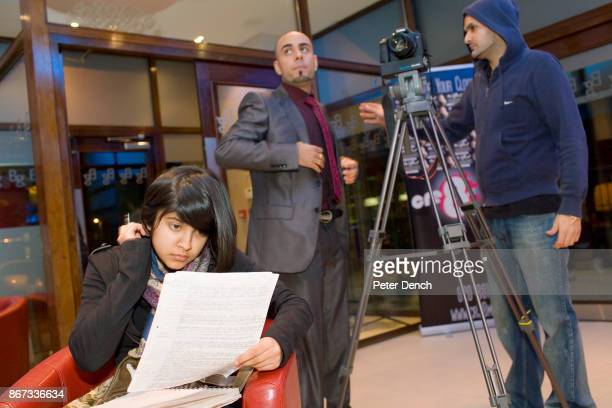 15 year old Robyn Kullar studying for a Science Exam at the filming of a music video for Bhangra sensation MC Special her uncle Blaise is the...