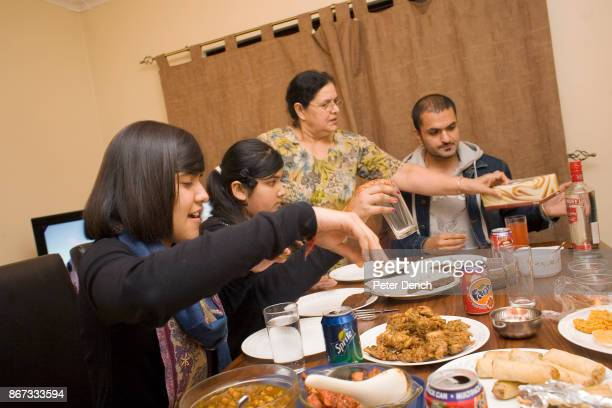15 year old Robyn Kullar with her sister Alisha grandmother Kuldeep and Uncle Blaise They are having dinner together for Diwali an important festival...